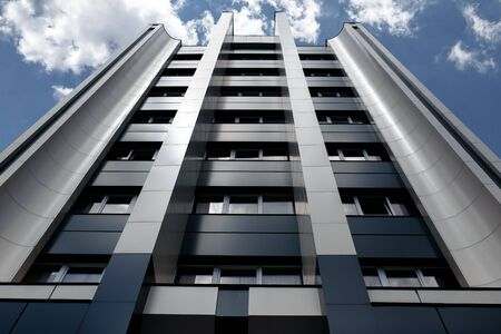 Photo of looking up modern metallic wall business or office building Stock Photo