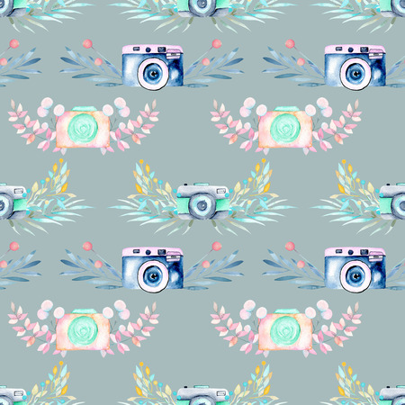 Seamless pattern with watercolor retro cameras in floral decor, hand drawn isolated on a blue background Stok Fotoğraf