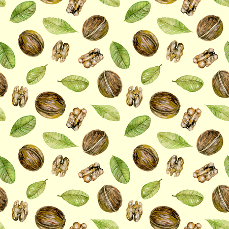 Seamless pattern with watercolor walnuts elements, hand painted isolated on a light yellow background Foto de archivo
