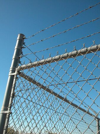 Security Fence with Barbwire Stock Photo