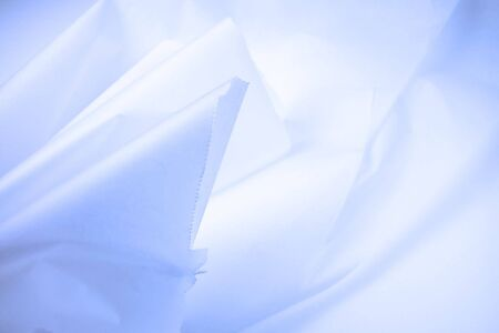 Macro shot of a bunch of wrinkled up parchment paper with a light blue tint-excellent for an abstract background Banco de Imagens