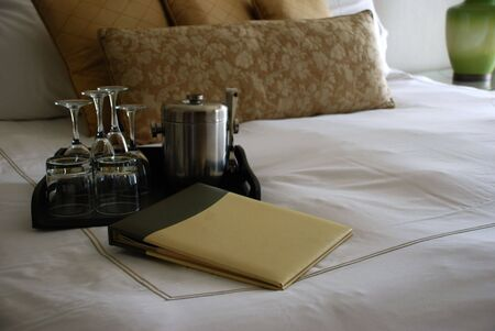 Luxury Hotel Room Bed with Drink Tray and Menu 免版税图像