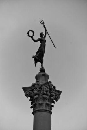 dewey: Union Squares Dewey Monument statue with pitchfork and laurel wreath