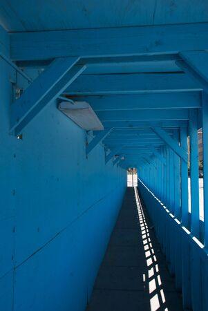 pedestrian walkway: Looking down a long pedestrian walkway at an urban construction site Stock Photo