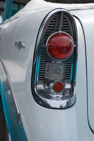 Tail light of a classic 1950s blue and white convertible car Stock Photo