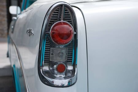 tail light: Tail light of a classic 1950s blue and white convertible car Stock Photo