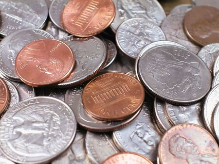 quater: Pile of US Quater Dollar Coins with others Stock Photo