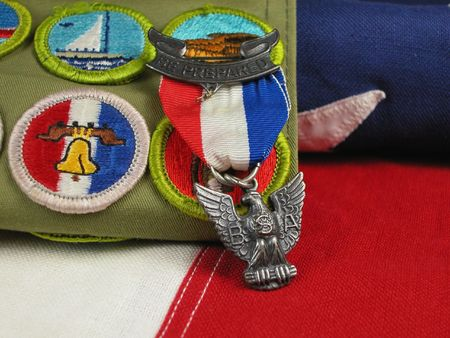 Close up of an Eagle Scout Award sitting on a Flag photo