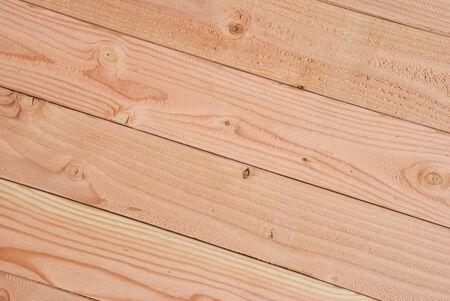 2x4: Edge to Edge Background of 2x4 Lumber on Angle Stock Photo