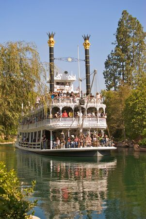 The Mark Twain Steamboat full of passengers at Disneyland in California