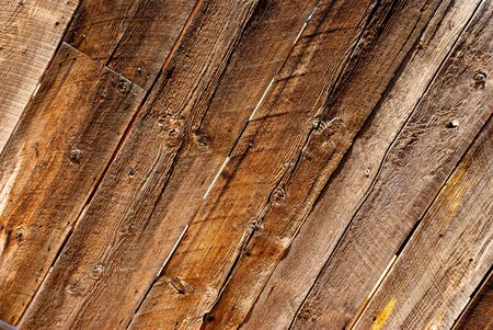 richly: Worn and weathered planks make up a richly grained wooden fence