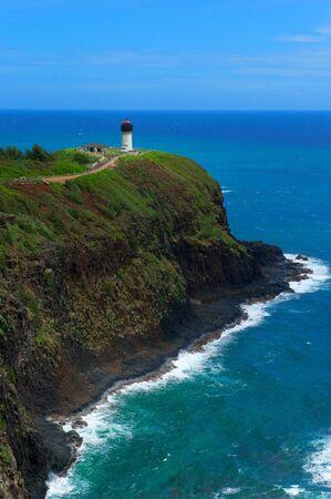 kilauea: A lighthouse atop a rock formation on the northern shore of island of Kauai, Hawaii, USA Stock Photo