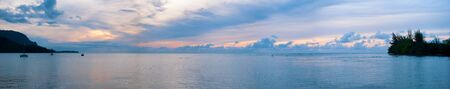 A panoramic shot of Hanalei Bay on the Island of Kauai in Hawaii at sunset