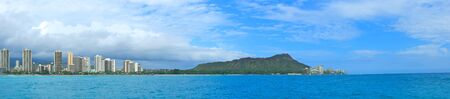 diamond head: A panoramic shot of Diamond Head and Waikiki Beach with the towering buildings of Honolulu towering in the background