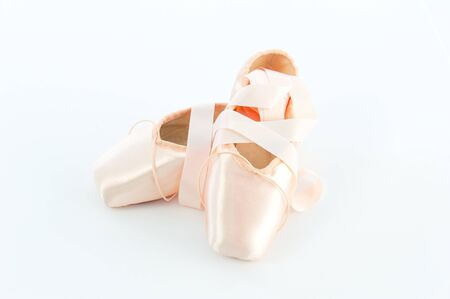 ballet slippers: A pair light or pale pink ballet point shoes or slippers isolated on a white background with a lot of copyspace Stock Photo