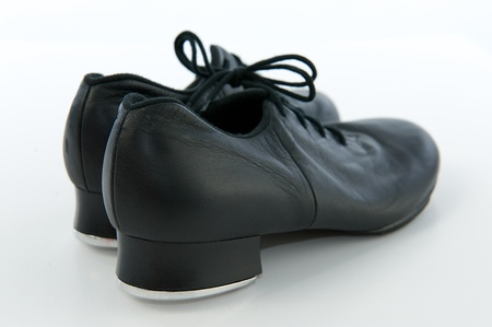 Pair of Black Tap Shoes looking at them from the heels