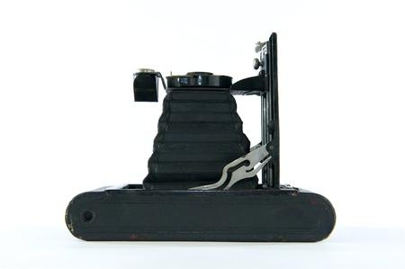 folding camera: Black vintage folding or accordian camera laying on it