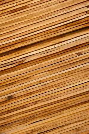 slant: Wooden planks stacked tightly together on a slant