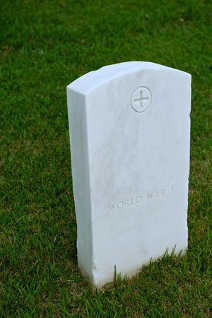military cemetery: White marble headstone or gravestone in a green military cemetery Stock Photo