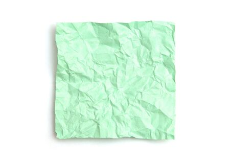 Green crumpled note paper isolated on white background photo