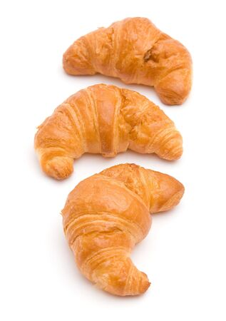 The image of three croissants isolated on white photo