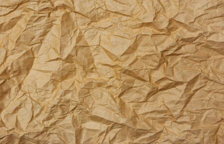 brown paper: Brown crumpled paper background texture