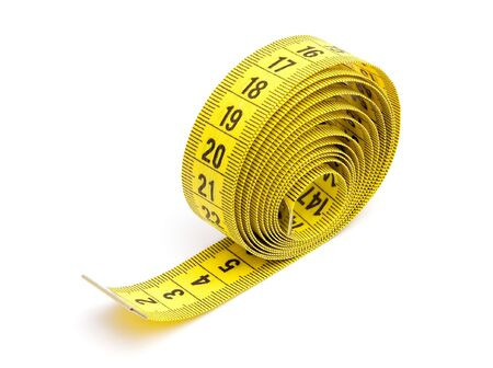 Yellow measuring tape isolated on white background Stock Photo - 6900151