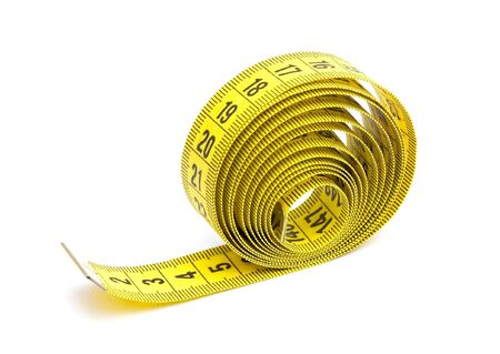 Yellow measuring tape isolated on white background Stock Photo - 7002196