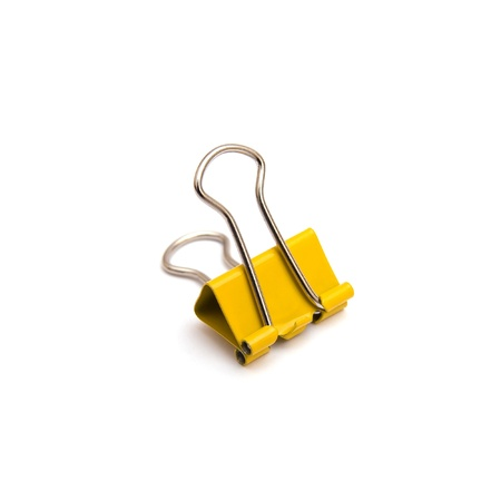Yellow binder clip isolated on white background