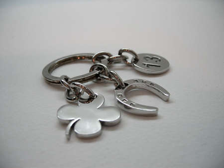 Metal keychain with trefoil, horseshoe and number thirteen photo