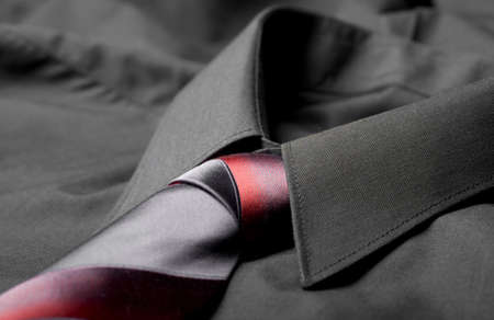 Black business shirt collar with the red and grey necktie photo