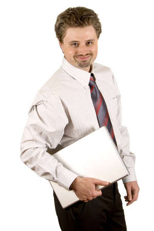 Young businessman is standing with the laptop and smiling photo