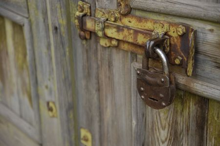 inhibition: The old metal lock hanging at the door
