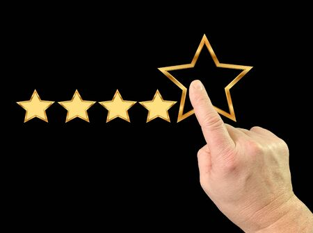 Index finger and five stars. Finger touch on the monitor. A man gives a high score with five stars. Concept: quality mark, level of service, high rating