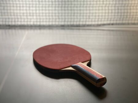 rackets on the tennis table. Racket for table tennis on a grid background. Concept: table sport.