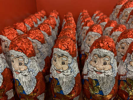 Candy in the form of Santa Claus. Christmas sweets on a supermarket shelf. Many colorful toys: Santa Claus.