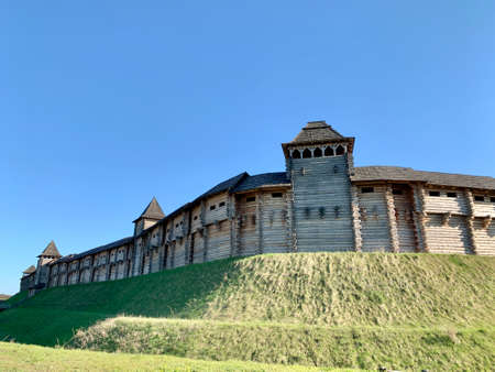 Wooden fortress wall against the sky. Medieval fortress with high walls. Wooden installation in the style of an ancient city. Park