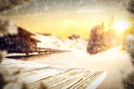 Snowy winter mountains and sunshine background and snowy wooden table space for products and decorations or text. Archivio Fotografico - 133353109