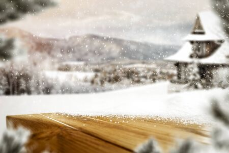 Snowy winter mountains and hut background with falling snowflakes and with space for your products and decoration. Happy Christmas time. Archivio Fotografico - 133353247