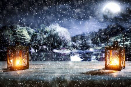 Snowy winter night landscape with wooden board top for products and decorations. Archivio Fotografico - 133353182