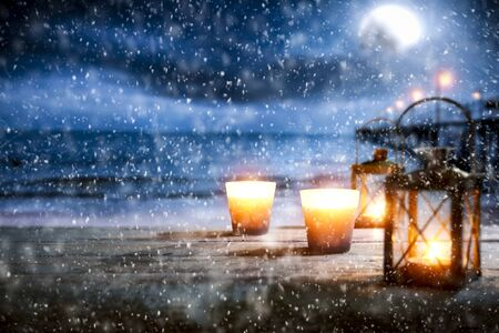 Snowy winter night landscape with wooden board top for products and decorations. Archivio Fotografico - 133353183