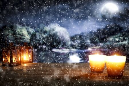 Snowy winter night landscape with wooden board top for products and decorations. Archivio Fotografico - 133353131