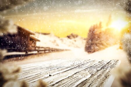 Snowy winter sunshine landscape with white wooden board top for products and decorations. Archivio Fotografico - 133353145