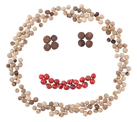 A smiling face made of pepper. Isolated on a white background.