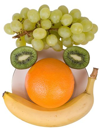 A smiling face made of fruits: grape, kiwi, orange and banana. Isolated on a white background.