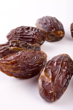 A circle of dried dates. Extreme close-up. Stock Photo