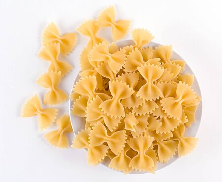 Pasta in a form of ties on a plate. Stock Photo