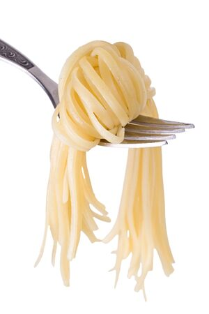 A knot made of spaghetti on a steel fork. Isolated on a white background.