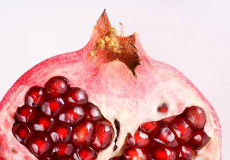 A half of a pomegranate close-up.