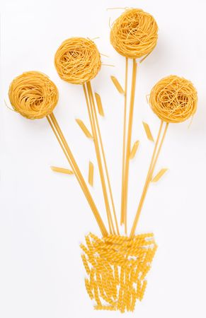A flower in a pot composition made of pasta and spaghetti. Stock Photo